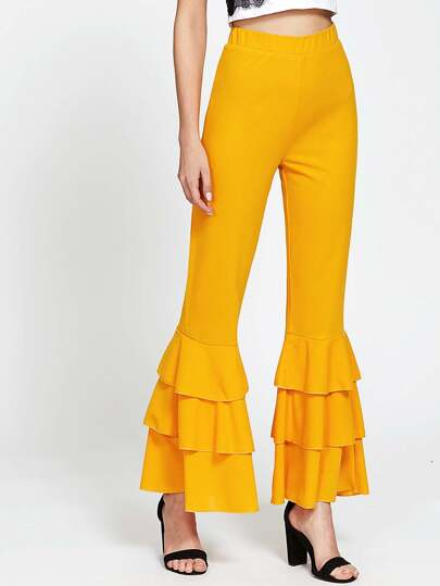 Pantalons bas cloche à étages avec des plis