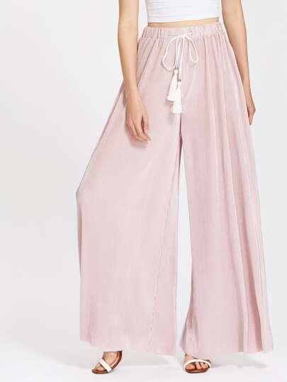 Pantalons avec des plis et une ceinture de frange