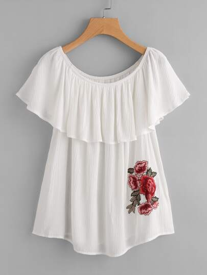 Top con applique di fiore ricamato