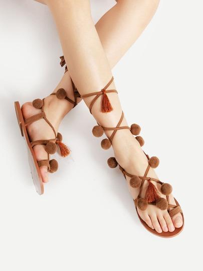 Sandales à lacets avec des pompons