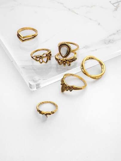 Ensembles d\'anneaux en forme de fleur creux avec pierre gemme