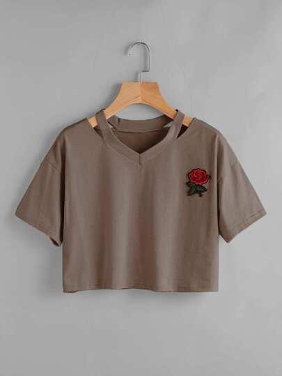 Camiseta con parche y abertura