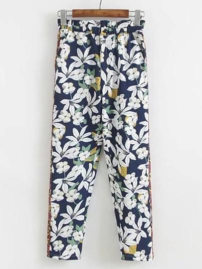 Pantaloni con stampa floreale a contrasto