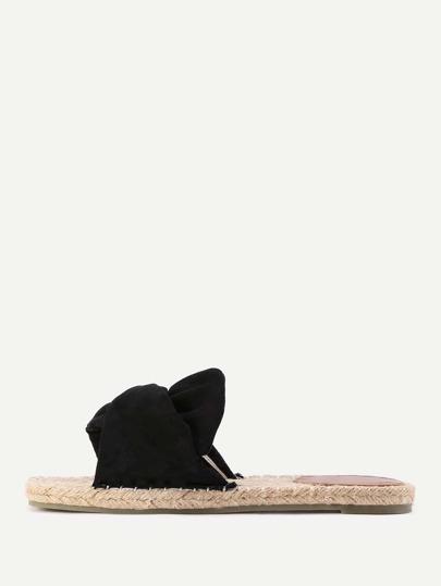 Sandalias planas en tejido con diseño de nudo