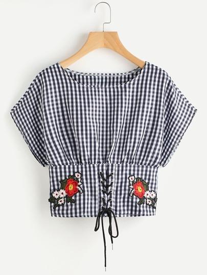 Blusa de cuadros con bordado y cordones