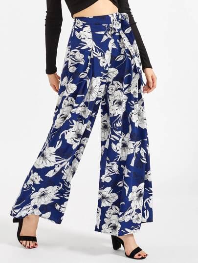 Pantalons imprimé fleuri avec une ceinture et des plis