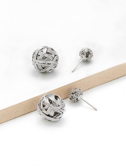 Boucles d\'oreille design de pompons creux
