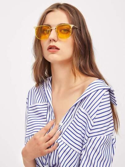 Gafas de sol con lente teñido con barra en el superior