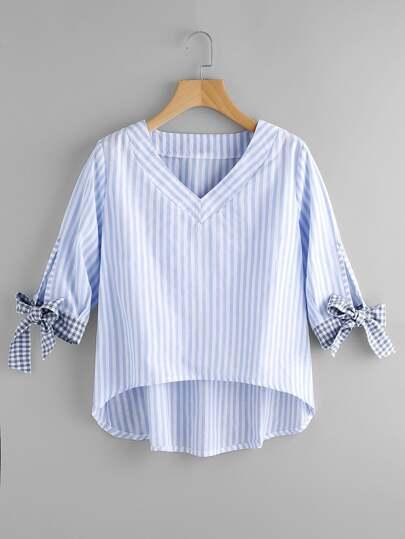 Blusa asimétrica de rayas con cordones