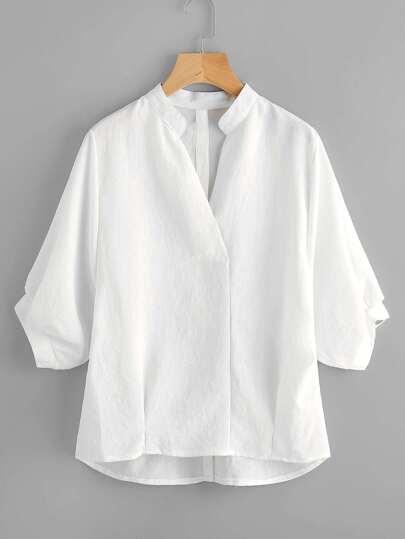 Blusa asimétrica de manga farol