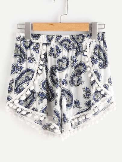 Shorts cruzado con ribete de pompones
