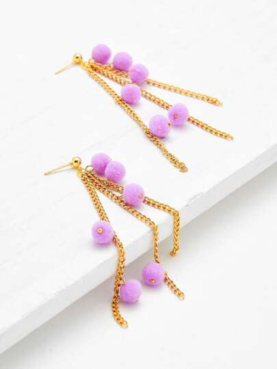 Aretes caídos con cadena con detalle de pompones