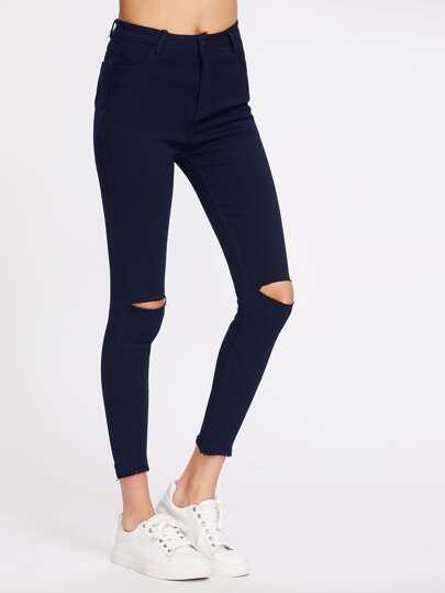 Jeans maigre lacéré découpé aux genoux
