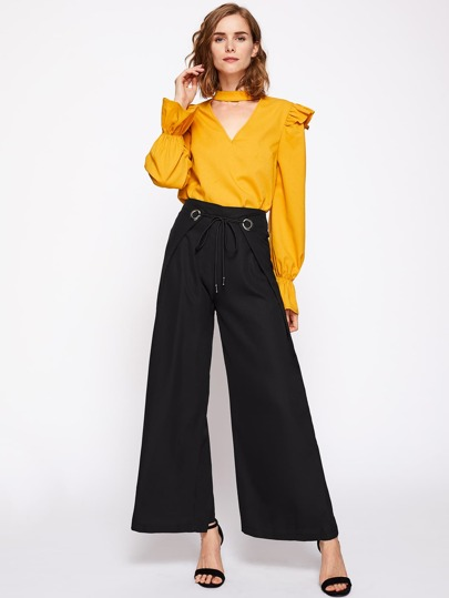 Pantalons avec une ceinture