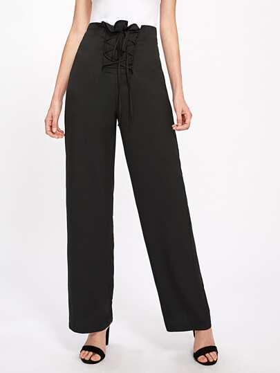 Pantalons à lacets avec des plis