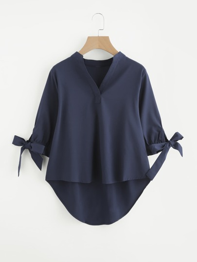 Bluse mit abfallendem Saum
