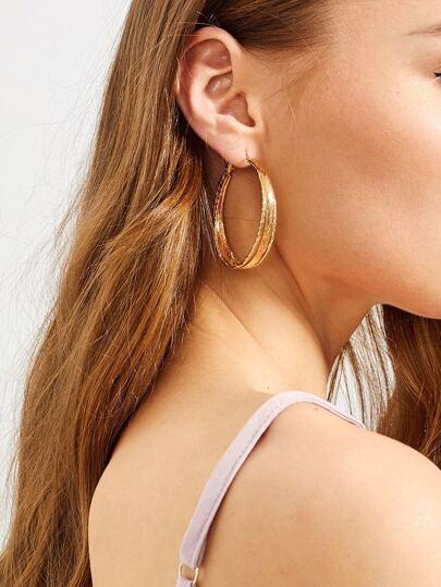 Orecchini con orecchini rotondi