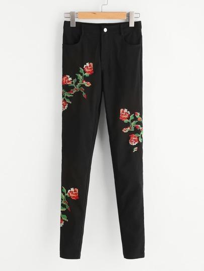 Pantaloni con ricamo di fiore