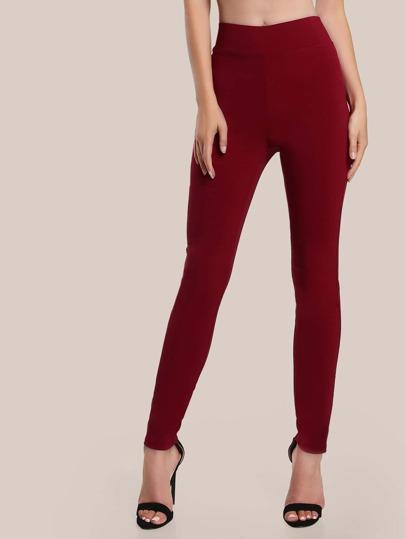 Pantaloni stretti con elastico in vita