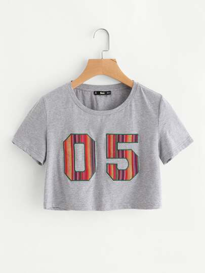 Camiseta corta con detalle de parche