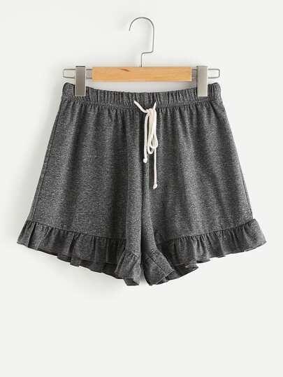Shorts en tricot avec une ceinture et des plis
