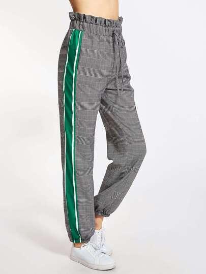Pantalones con volante con raya lateral