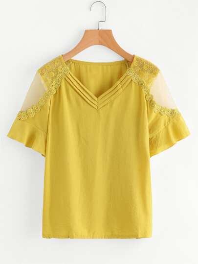 Blusa con malla insertada aplique bordada de croché