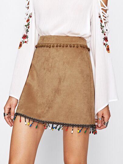 Falda de ante con cinta bordada y pompones