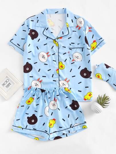 Schlafanzug mit Karikaturmuster und Augenmaske