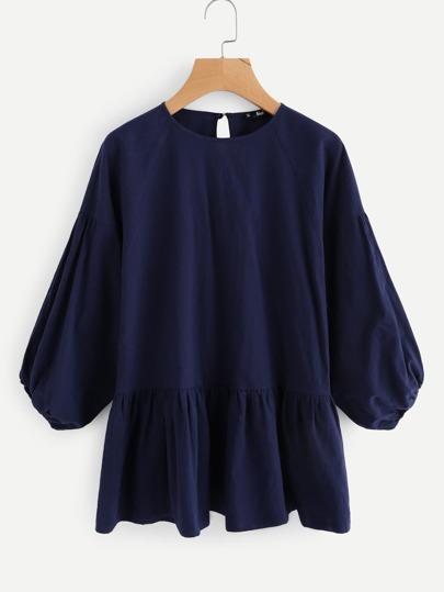 Gesmockte Bluse mit Knöpfen und Schlussloch hinten