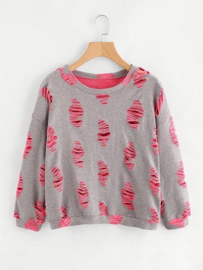Pull-over lacéré en tricot