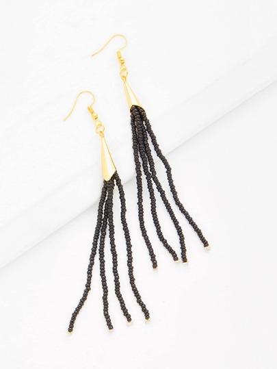 Boucles d\'oreille longues avec des franges de perle