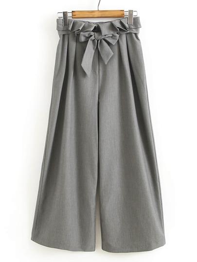 Pantalons jambe large découpé avec des plis et une ceinture de nœud papillon