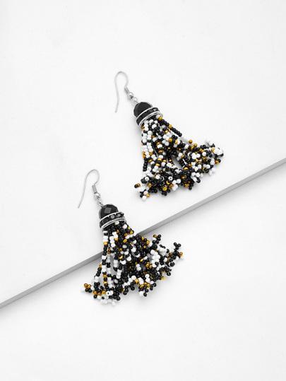 Boucles d\'oreille en forme de frange design de perle