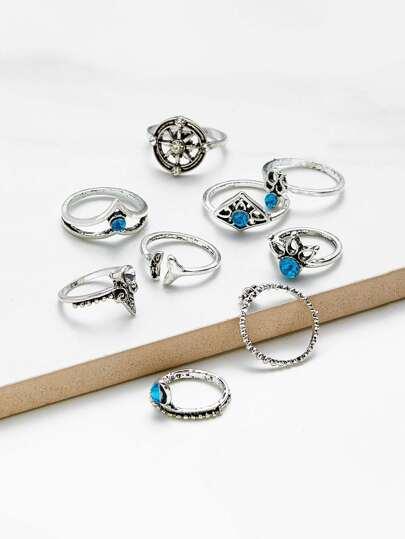 9 piezas de anillos en diversas formas con pedrería