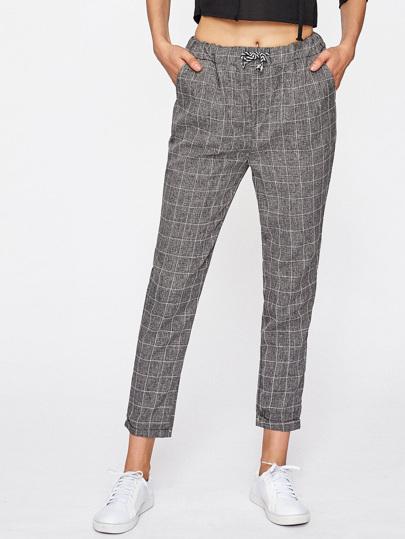 Pantalones de cuadros con cordón