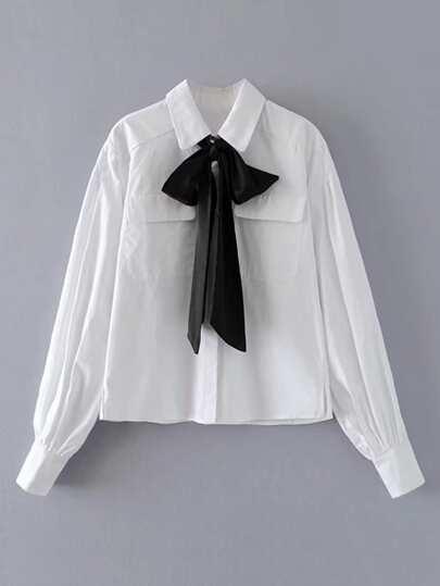 Blusa con bolsillo y lazo para atar
