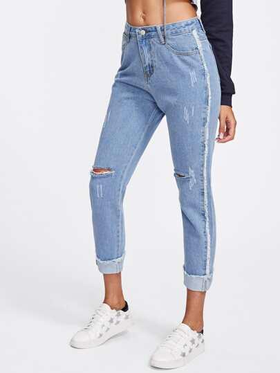 Jeans avec ourlet de pan avec trou au genou