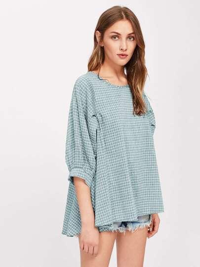 Blusa asimétrica con estampado de cuadros