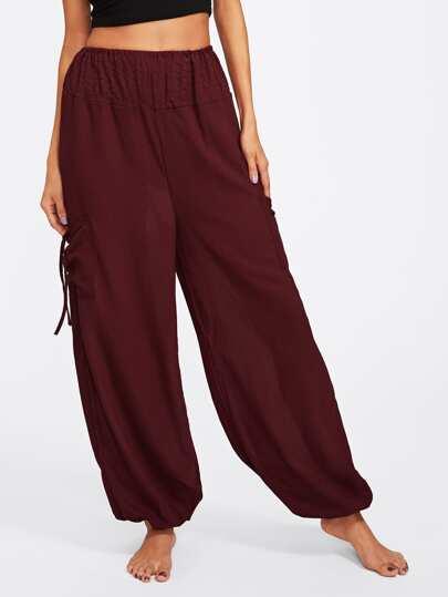 Pantalones yoga amplios con bolsillo lateral