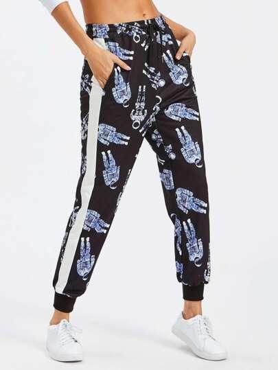 Pantalons bicolore rayure imprimé astronaute