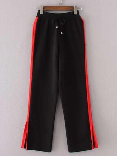Pantalones a rayas con abertura al lado