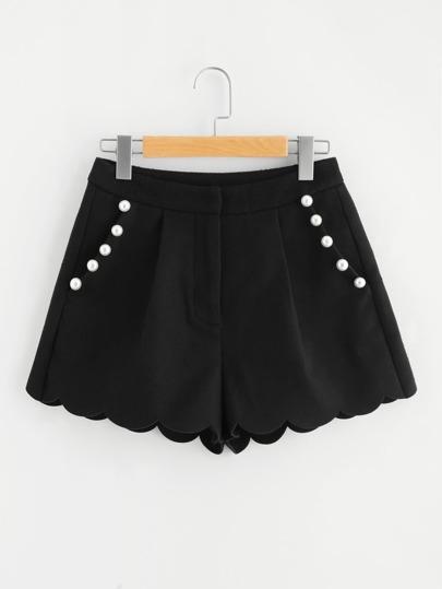 Pantaloni con fondo smerlato