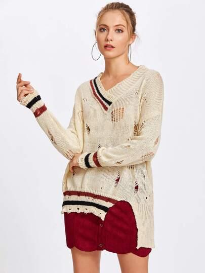 Suéter roto ribete de rayas escote V