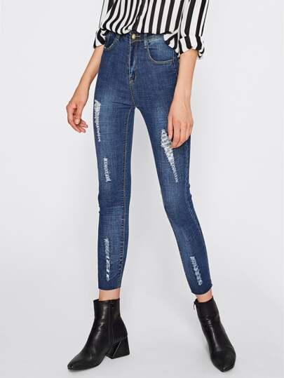 Jeans moulant avec trou