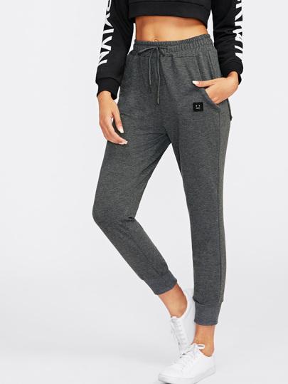 Pantalons avec pièce