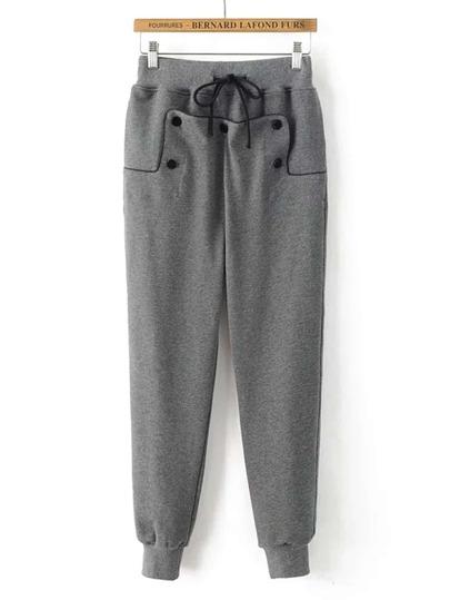 Pantalones con detalle de botón y cordón