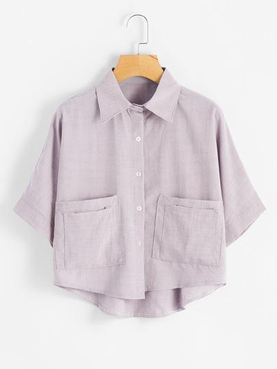 Blusa asimétrica con dos bolsillos