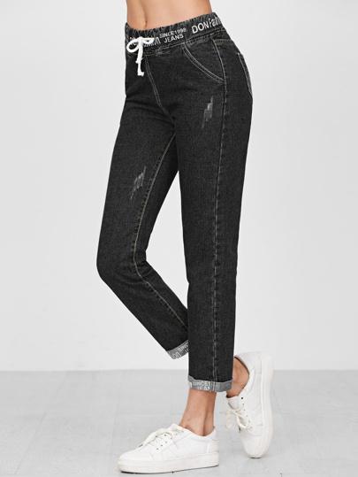 Jeans mit Kordelzug um die Taille und gerollten Manschetten