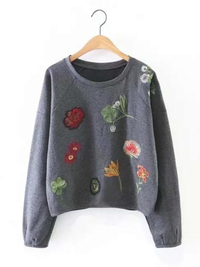 Sweat-shirt manche raglan brodé des fleurs